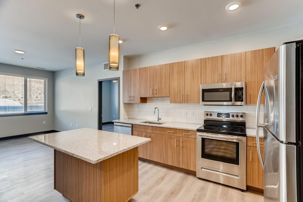 Modern kitchen with stainless steel appliances - Six Canyon