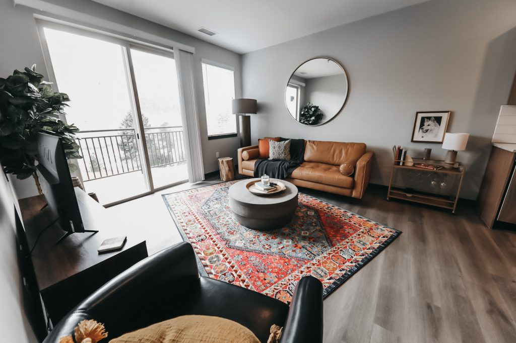 Living room with patio view - Six Canyon Apartments